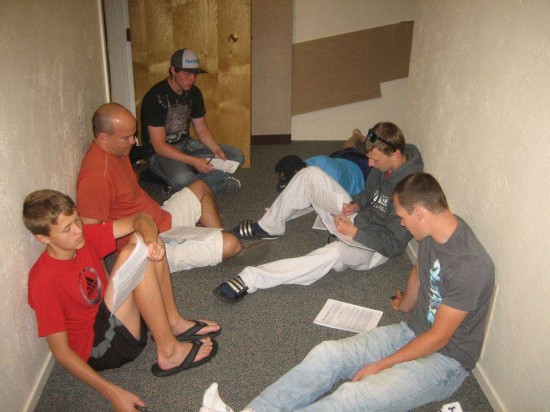 A group of students and leaders prepares to meet with an atheist.