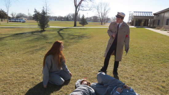Anna Musgrave, Lydia Langmeier, Jessica Hilderbrand, and Cole Ruybalid recreate a powerful scene in the One Act one last time. This is the final scene between Elise (Musgrave) and Otto (Ruybalid). Otto recognizes Elise from the SS St. Louis journey and remembers the conflict they had. He then kills Elise, breaking the bond of love she had with Jacob.